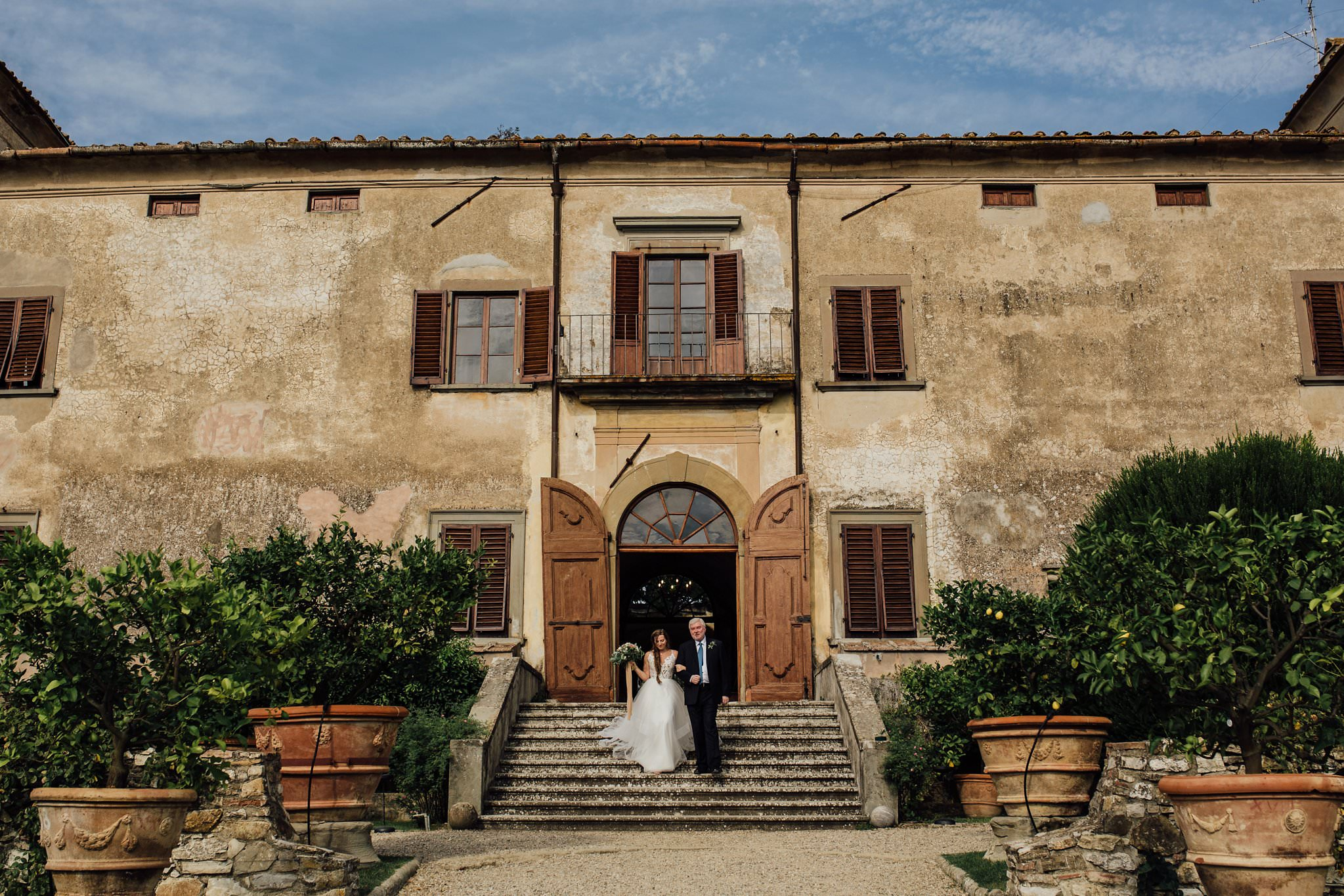 bride on steps at Villa Medicea di Lilliano, Florence Italy